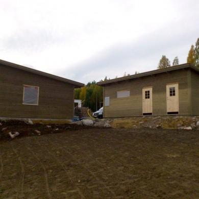 Tillbyggnad med garage, förråd och bastu